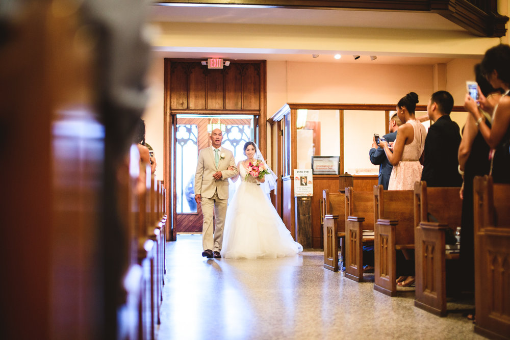 012 bride processing through church escorted by her father.jpg