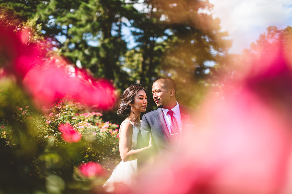 028 bride and groom portrait among pink and red flowers.jpg