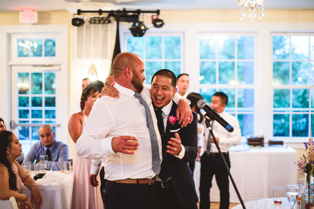 046 groom laughs with groomsman.jpg