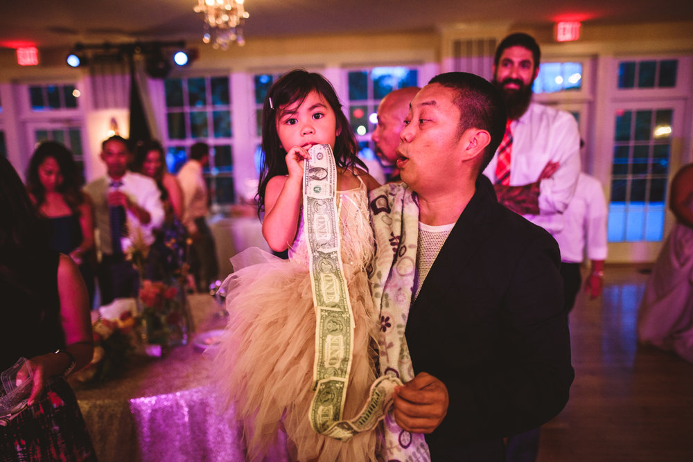051 a wedding guest eating money.jpg
