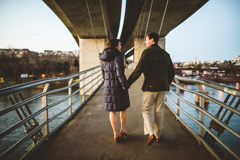 013 - couple walking along the belle isle walking bridge richmond virginia engagement photographer nathan mitchell.jpg