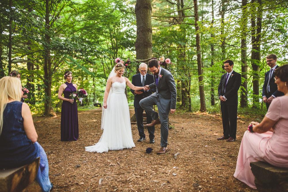 010 - mazel tov groom breaks glass during jewish wedding ceremony.jpg
