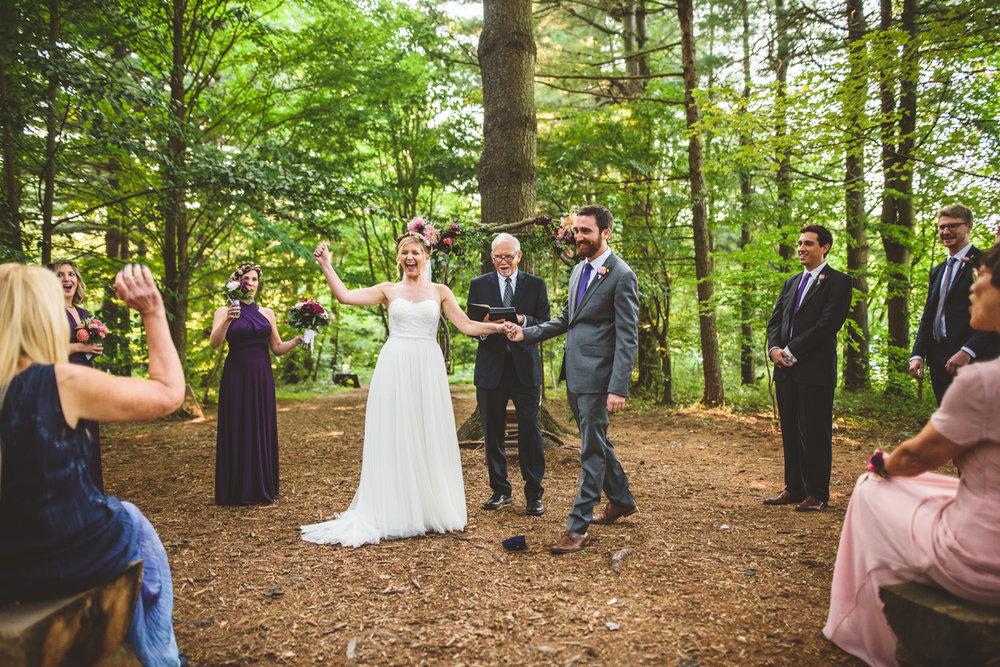 011 - mazel tov bride celebrates after groom breaks wedding glass.jpg