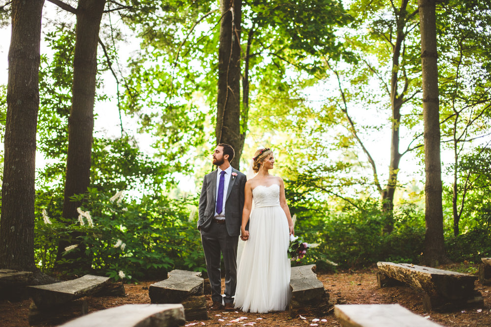 013 - bride and groom take portraits in the forest where they were married.jpg