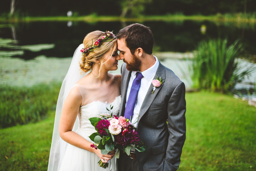 016 - bride and groom portrait in front of a lake.jpg