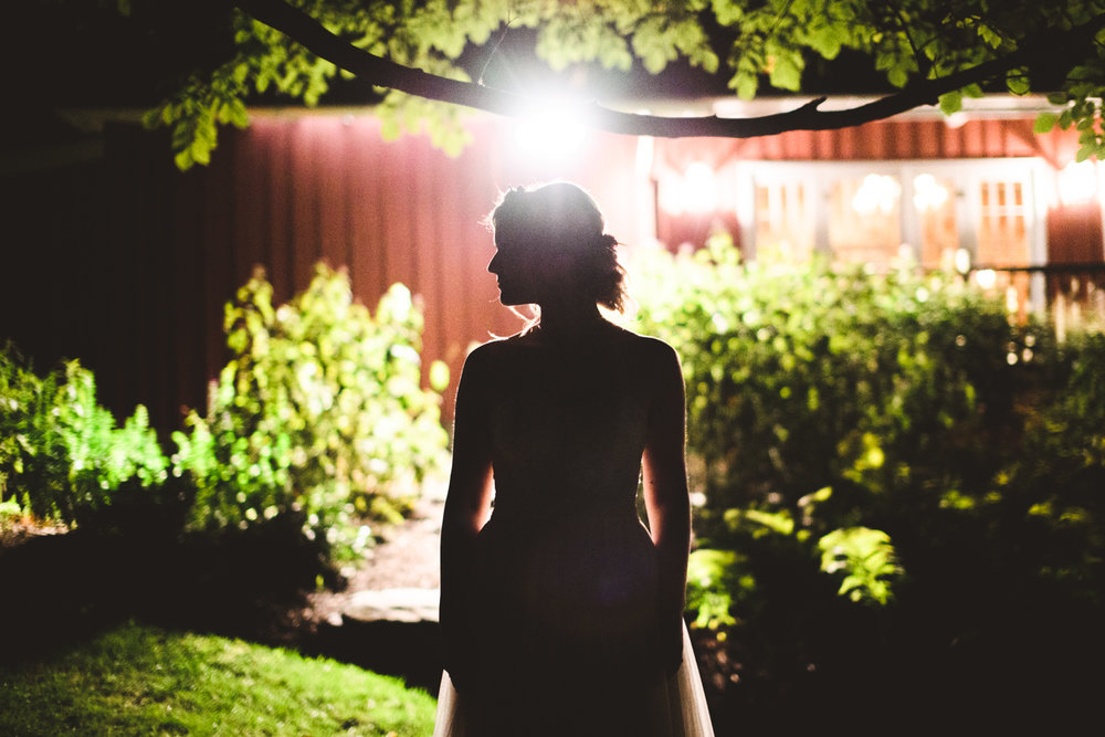 031 - creative photo of bride silhouetted against barn light.jpg