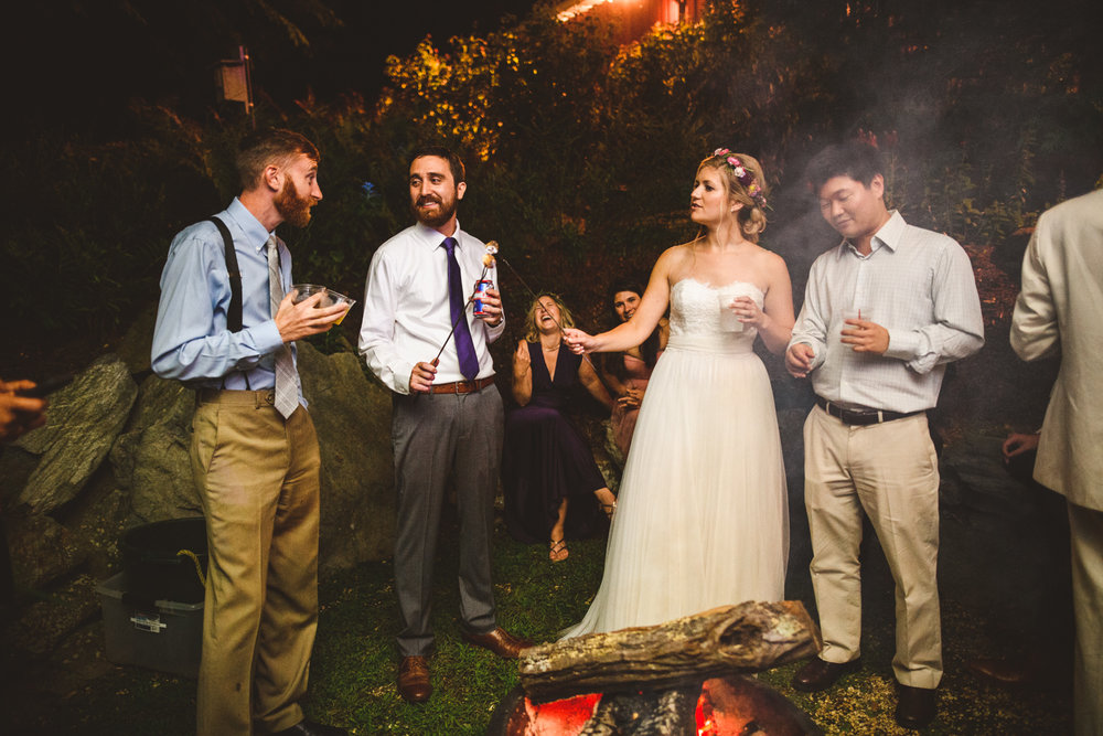 035 - bride and groom feeding each other smores at their wedding richmond wedding photographer nathan mitchell.jpg