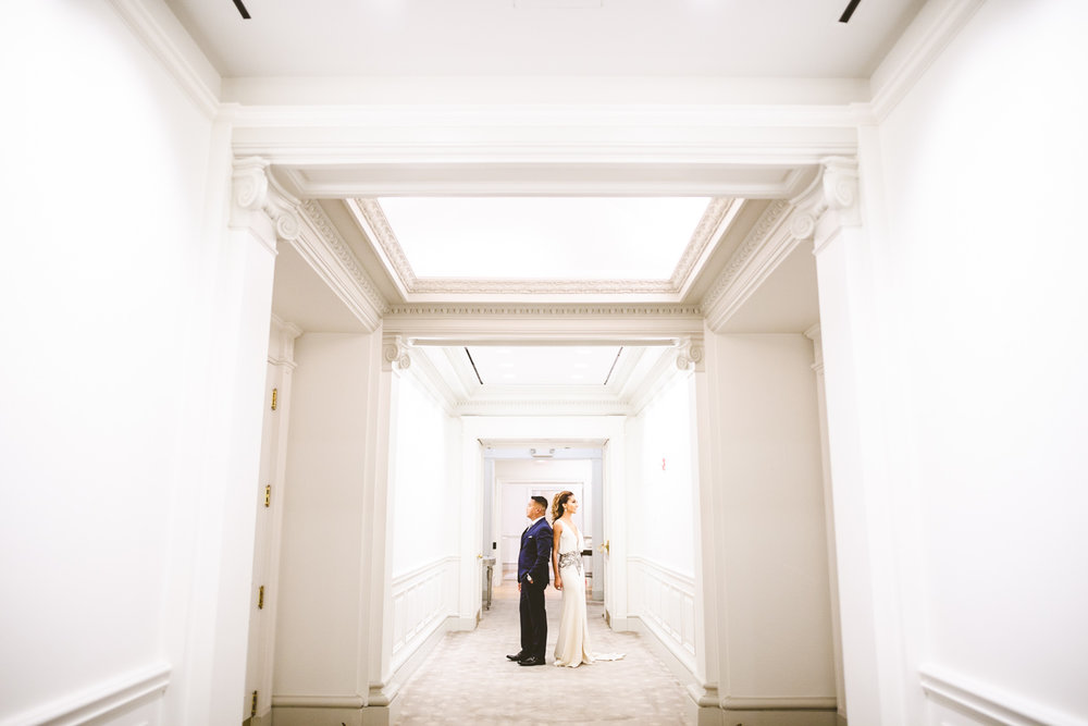 006 - wide engagement portrait in hotel hallway.jpg