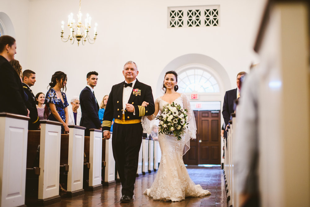 005 bride and bride's father walking down the aisle at fort myer old post chapel.jpg