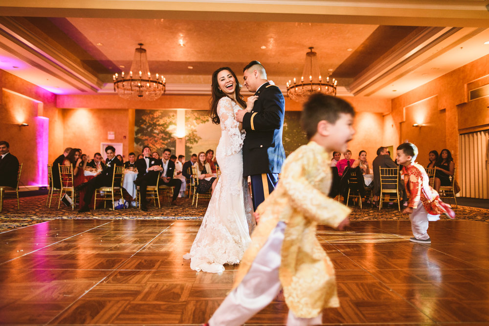 016 kids running around during the first dance as the bride laughs.jpg