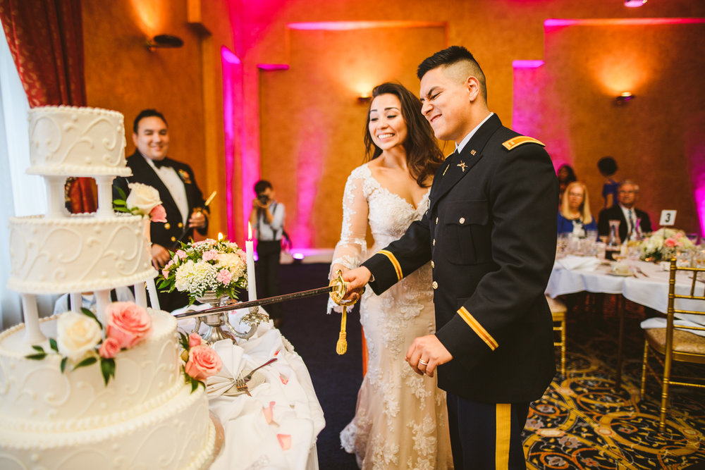 018 bride and groom cut the cake with a sword at a military wedding.jpg