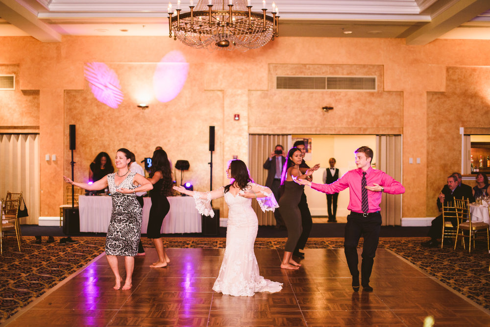 020 bride and wedding guests do a traditional hula dance.jpg