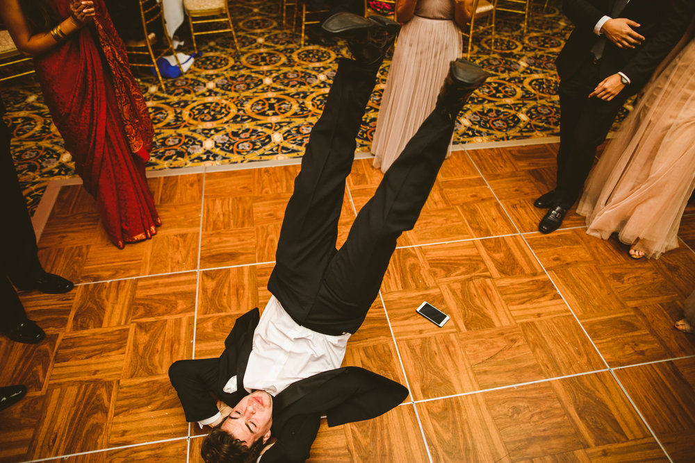 022 wedding guest breakdances at a wedding at fort myer.jpg