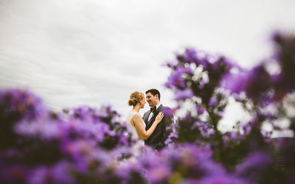 008 - beautiful photo of bride and groom in gorgeous purple flowers.jpg