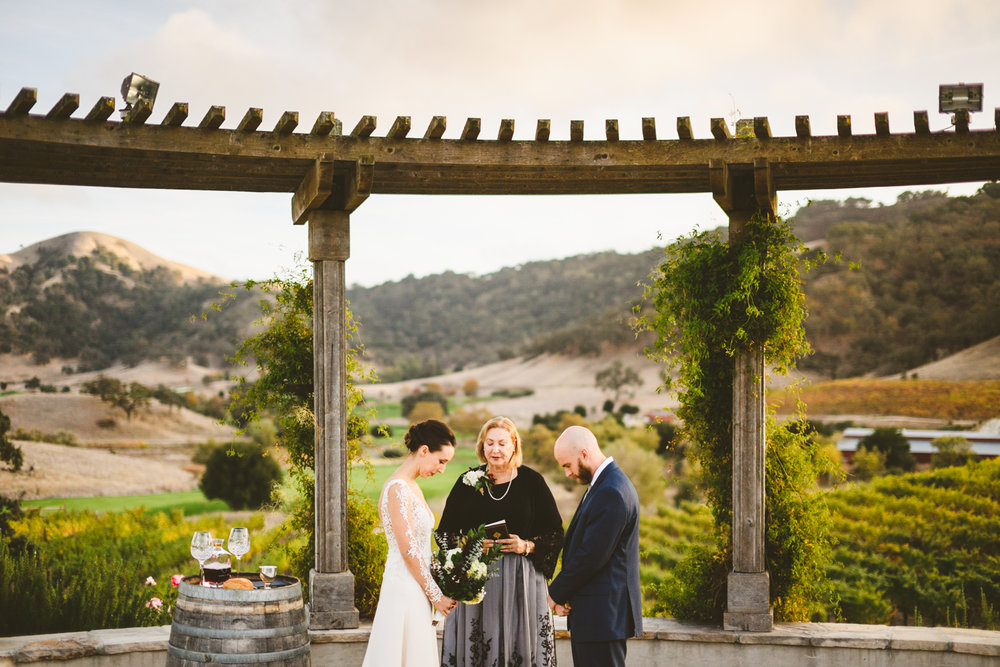 016 - bride and groom pray during their vineyard wedding ceremony at clos la chance wines in san jose california.jpg
