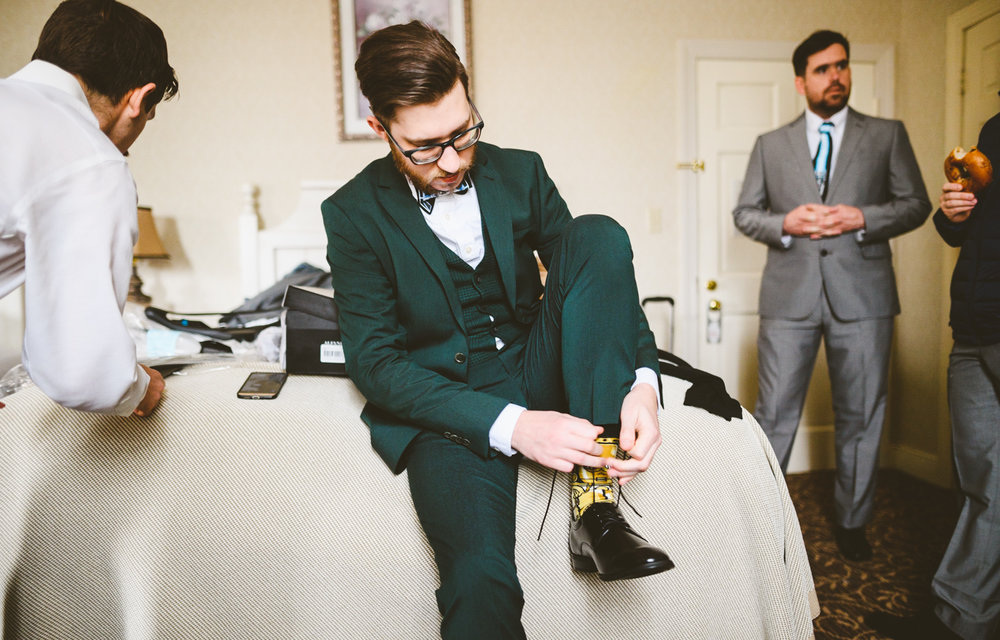 002 - groom putting on shoes - richmond wedding photographer.jpg