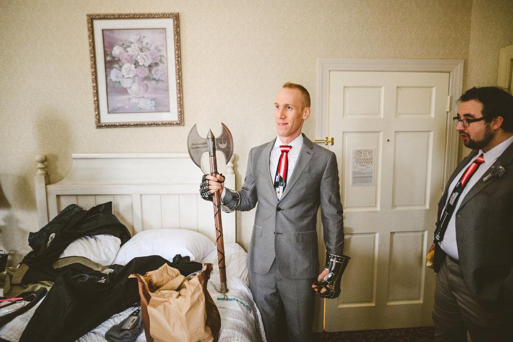 005 - groomsman holding giant wedding axe.jpg