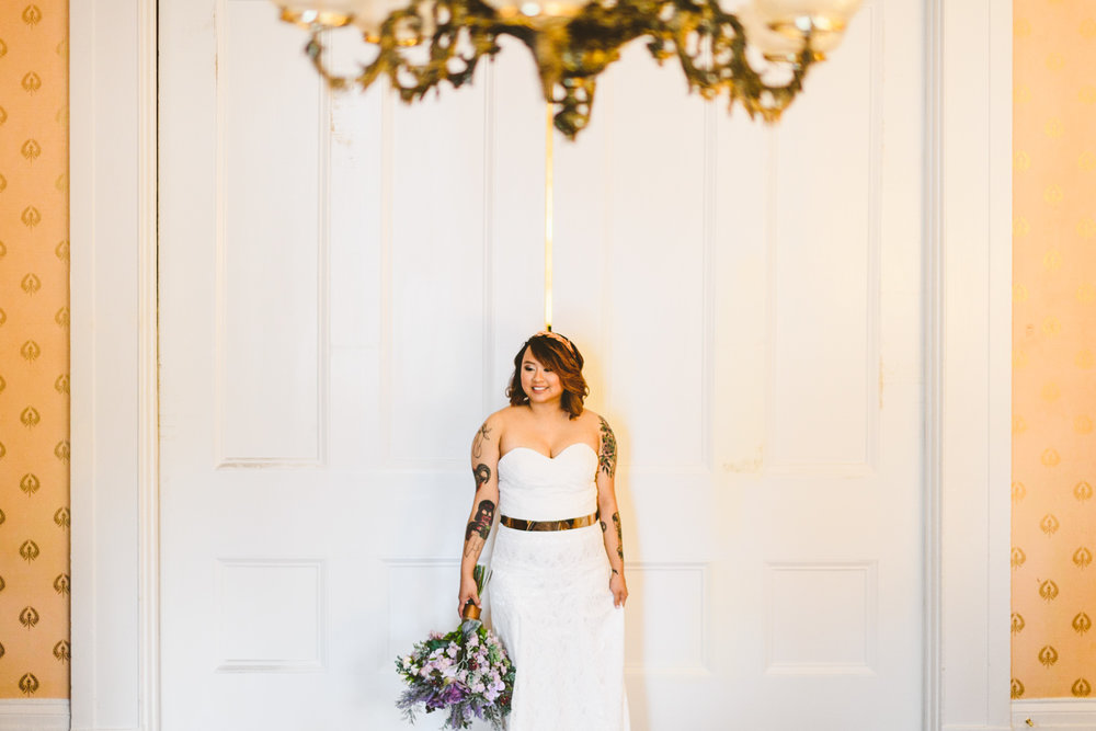 006 - bride with bouquet against beautiful white pocket doors at Linden Row Inn.jpg