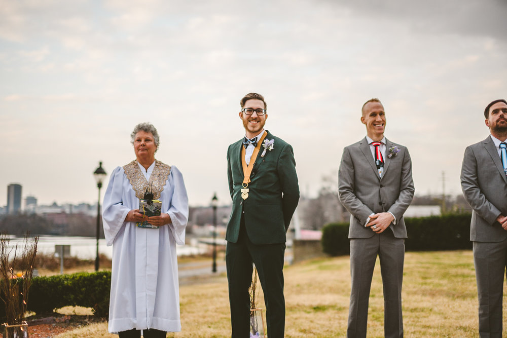 010 - groom waits for bride at rocketts landing in richmond.jpg