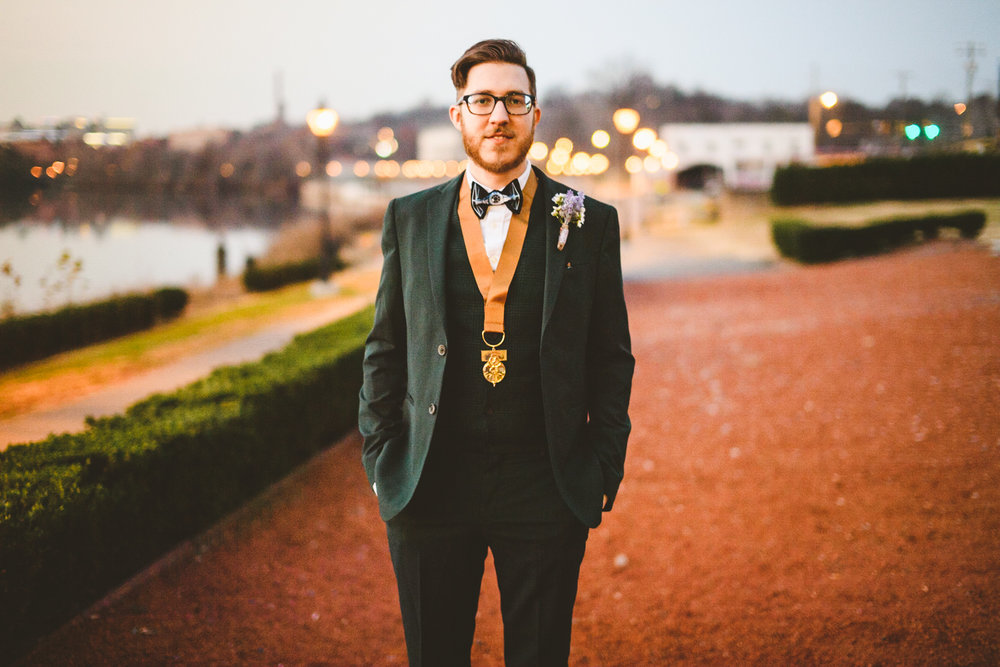 026 - groom poses for portrait at rocketts landing in richmond virginia.jpg