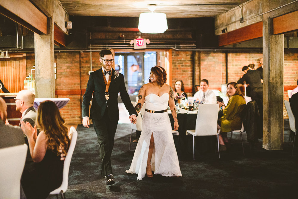 029 - bride and groom enter their reception at the boathouse restaurant.jpg