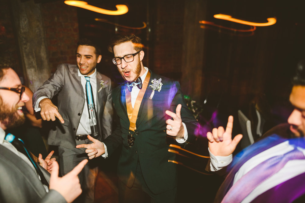 034 - groom dancing during star wars themed wedding.jpg