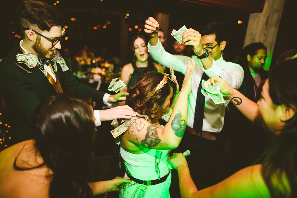 039 - bride and groom are showered with money during the money dance at a wedding in richmond virginia.jpg