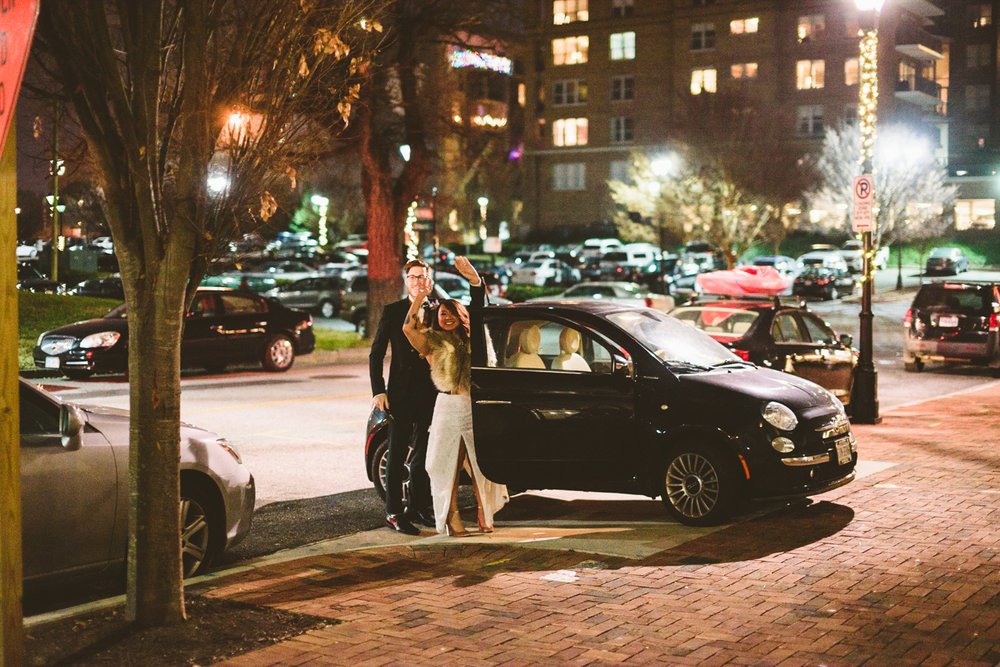 048 - bride and groom wave from their car as they exit their wedding in richmond wedding photographer nathan mitchell.jpg
