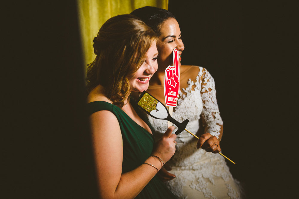 044a - bride and maid of honor take a photo booth photo.jpg