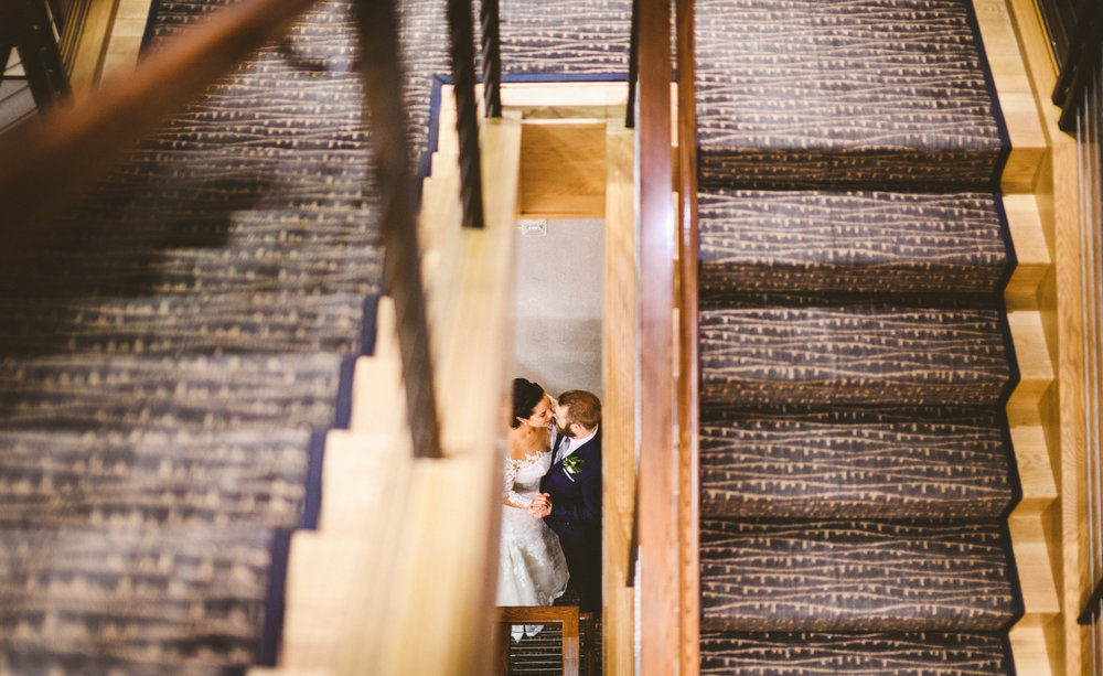 046 - portrait of bride and groom in stairwell.jpg