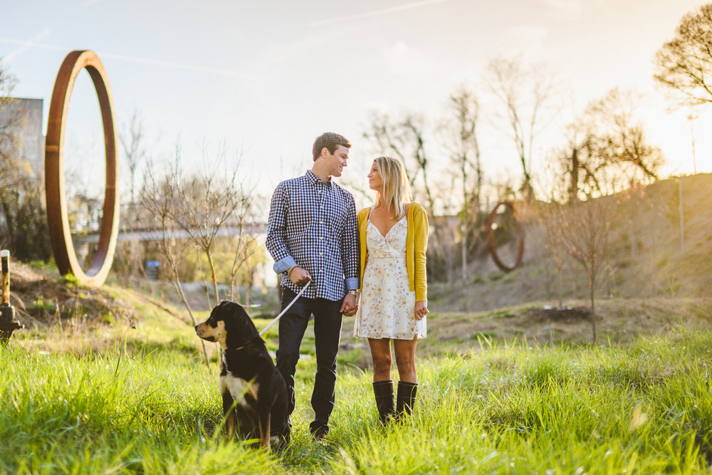 002 - couple poses with their dog for an engagement photo.jpg