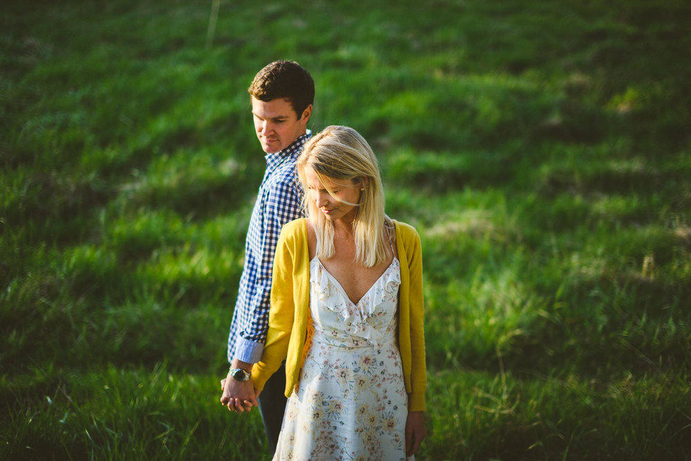 009 - couple against green grass backdrop in creative pose.jpg