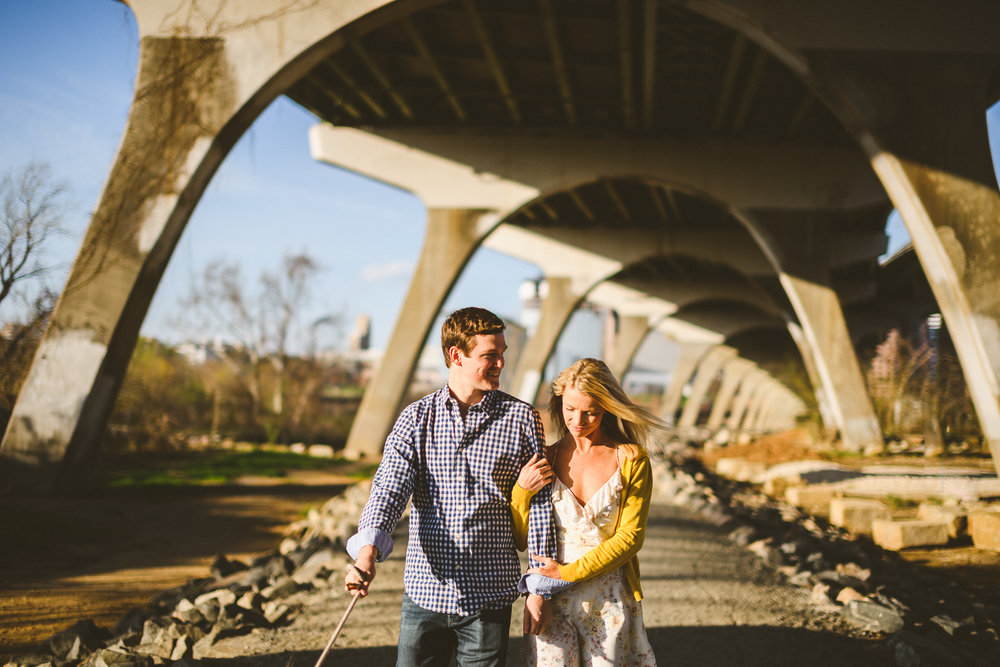 010 - couple walking and laughing together under manchester bridge richmond virginia wedding photographer.jpg