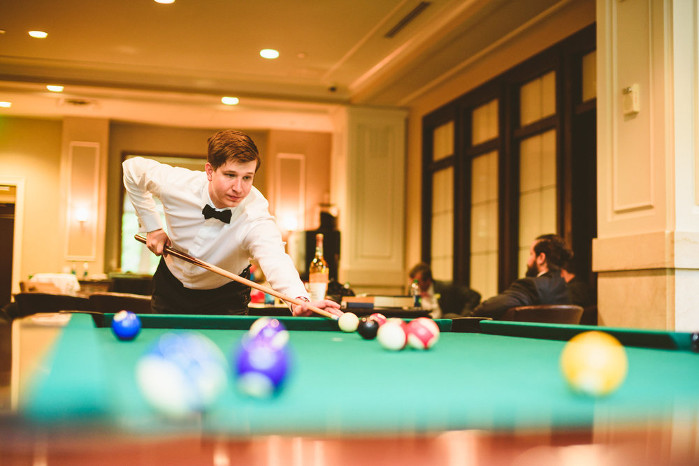 002a - groom plays pool while getting ready for his wedding.jpg