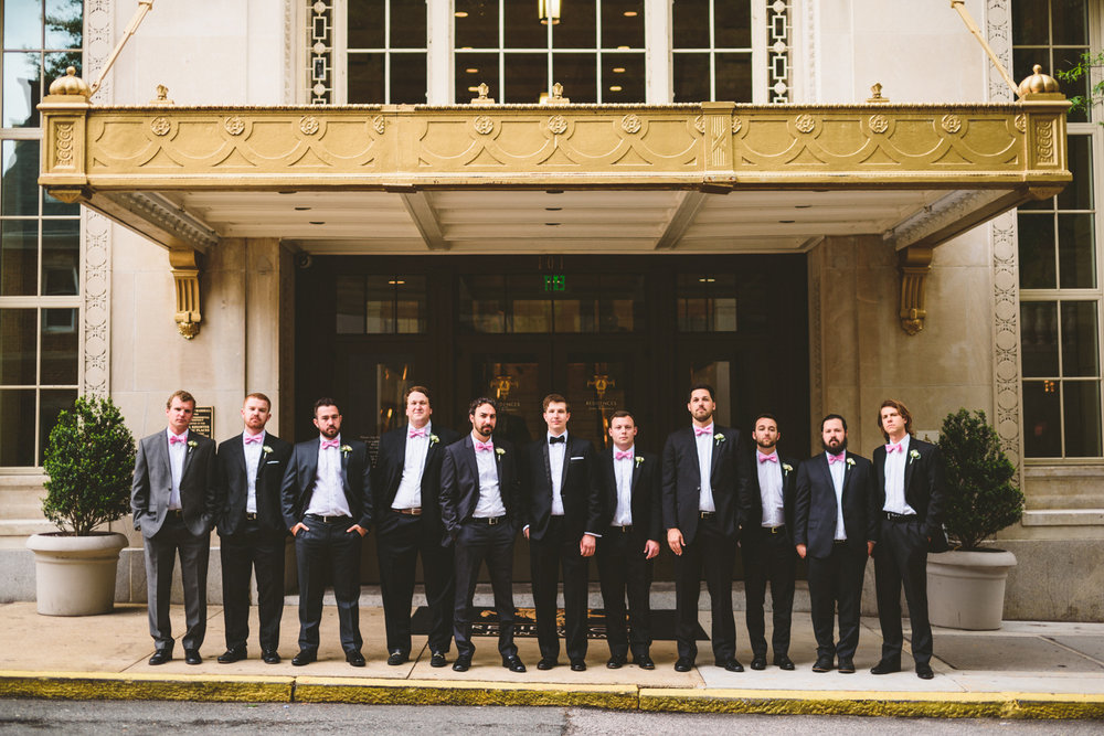 012 - groomsmen portrait under the awning at hotel john marshall in richmond virginia.jpg