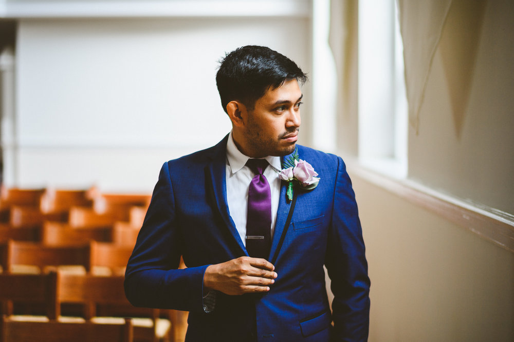 006 - portrait of the groom in blue suit in the chapel where he will be married.jpg