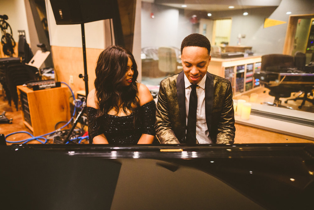 003 - couple plays piano together in a recording studio on their engagement session virginia.jpg
