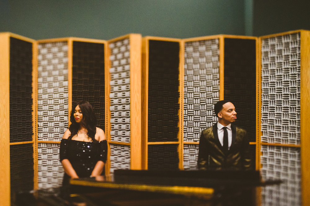 006 - couple against acoustic panels on their engagement session virginia.jpg