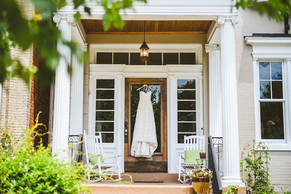 001 - dress hanging from front door richmond wedding photographer nathan mitchell.jpg