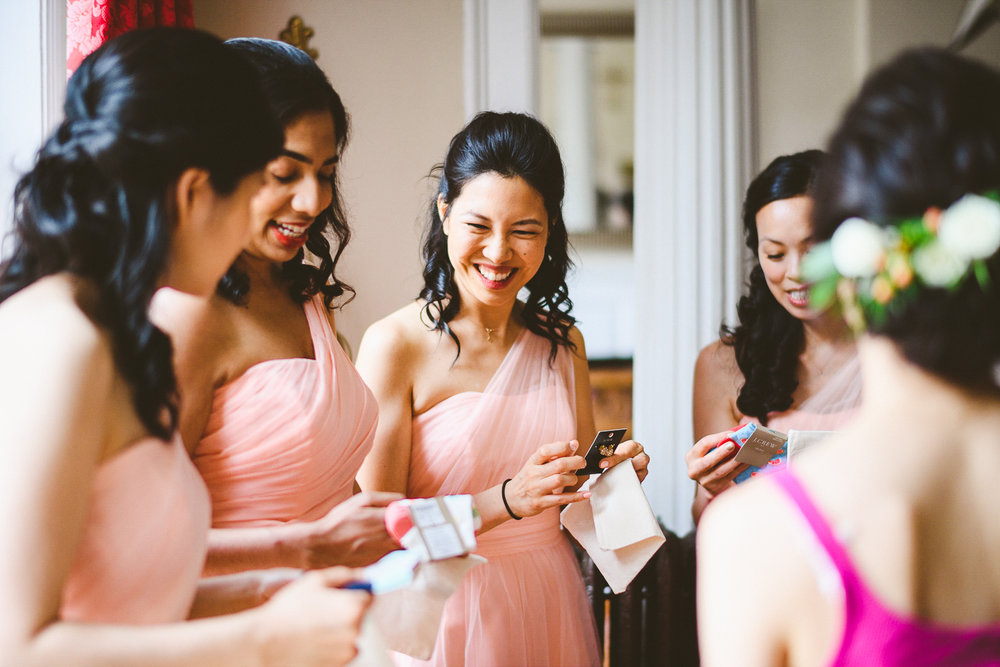 004 - bridesmaids opening their gifts from the bride.jpg