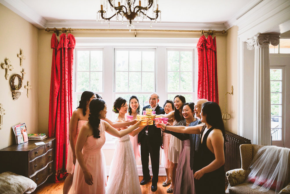 008 - bride's family toasting the bride in the bridal suite.jpg