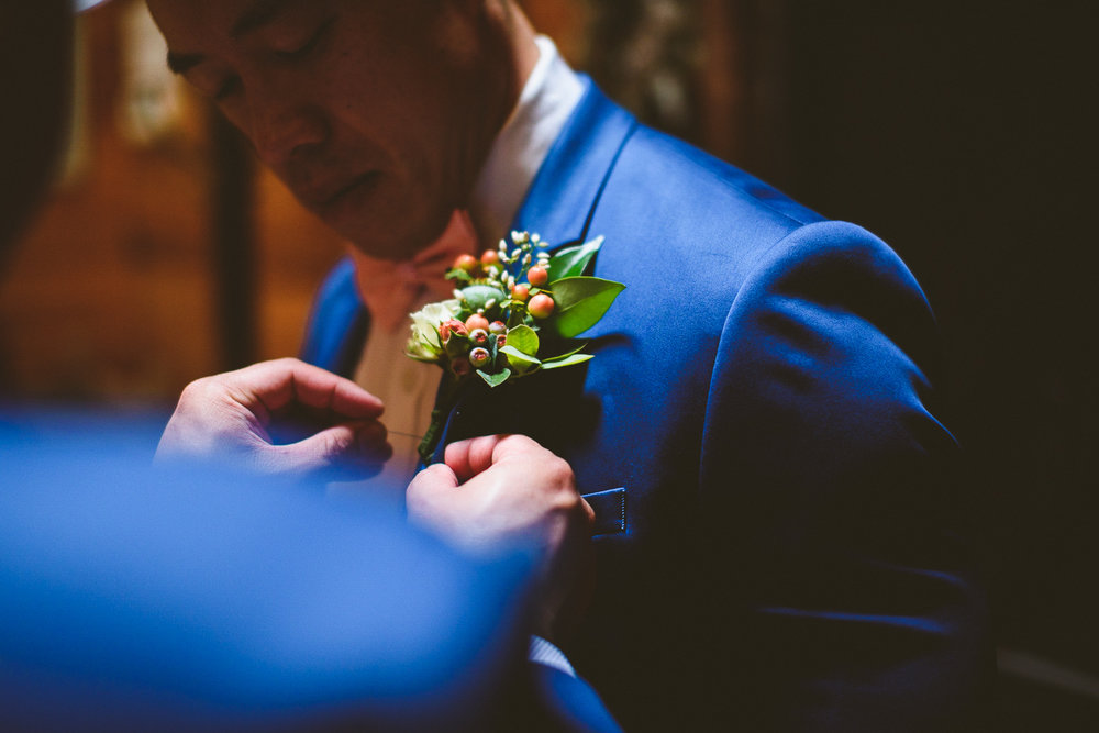 011 - groom getting his boutonniere pinned.jpg