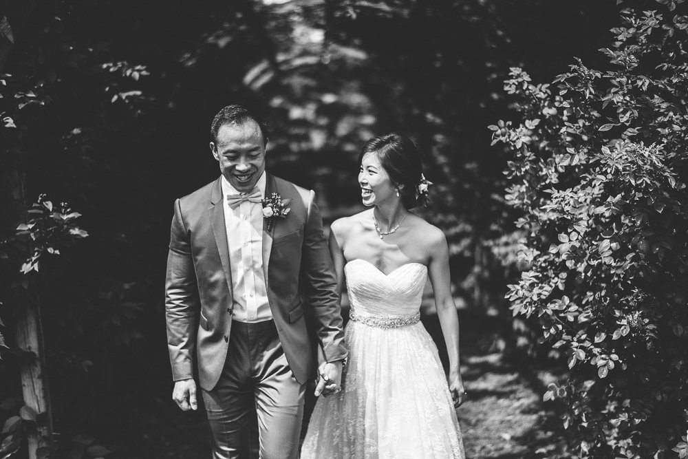 014 - black and white bride and groom laughing and walking together.jpg