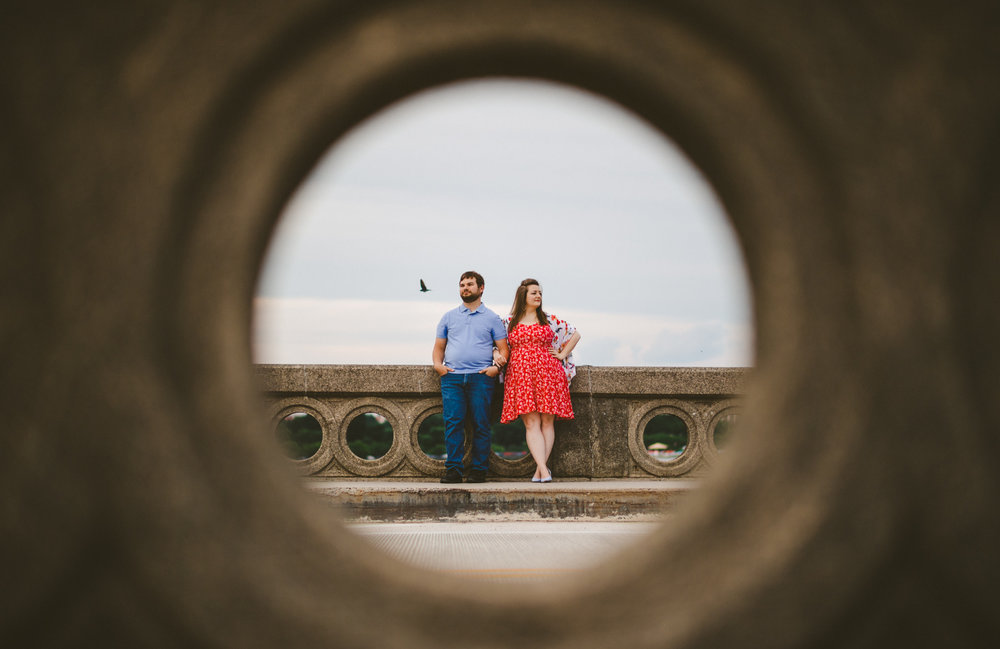 008 - great engagement photo through porthole on bridge washington dc wedding photographer.jpg