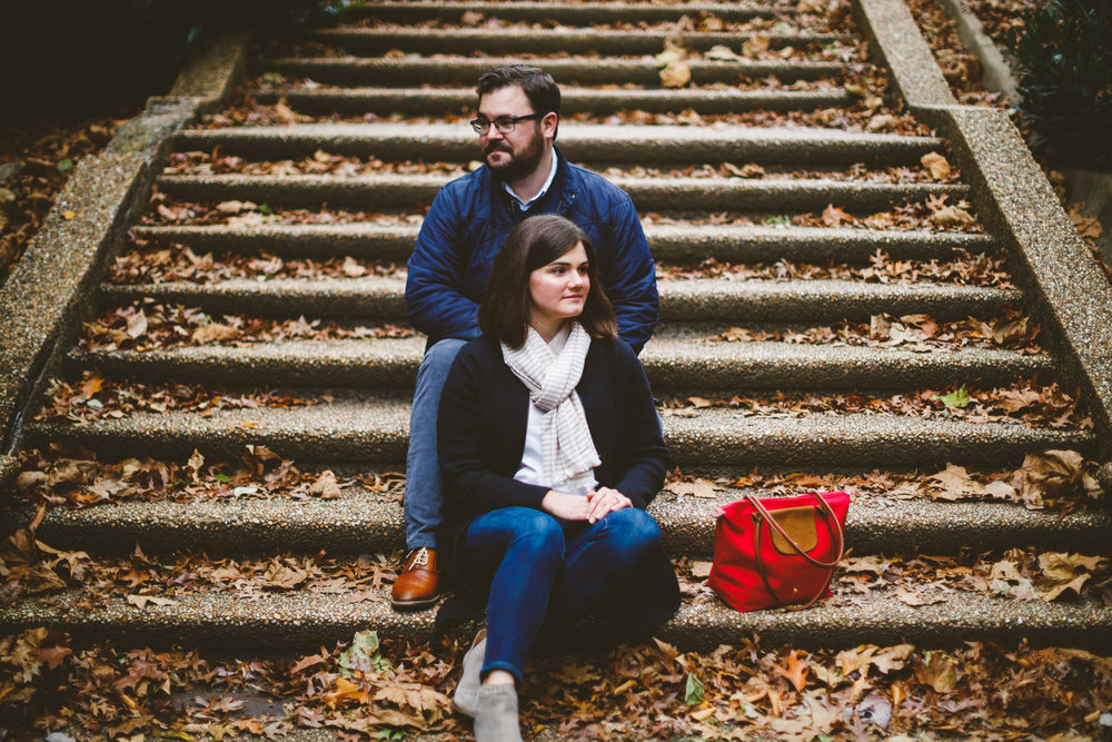 014 - engagement portraits on steps in Meridian Hill Park in washington dc with red handbag.jpg