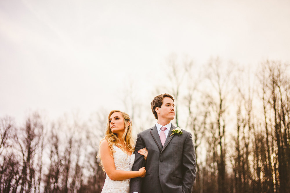 017 - portrait of bride and groom in front of trees.jpg