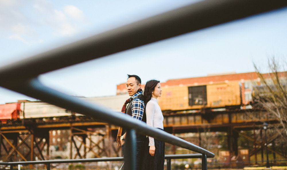 019 - richmond train passes behind couple in cool creative portrait.jpg