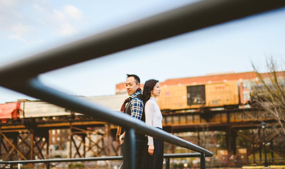 019 - richmond train passes behind couple in cool creative portrait.jpg