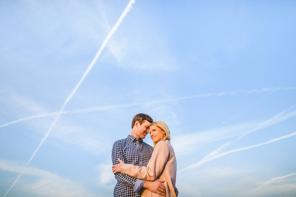 029 - couple against backdrop of blue sky with jet trails.jpg