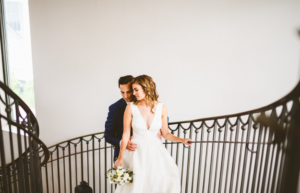 034 - bride and groom on stairs with railing south carolina.jpg